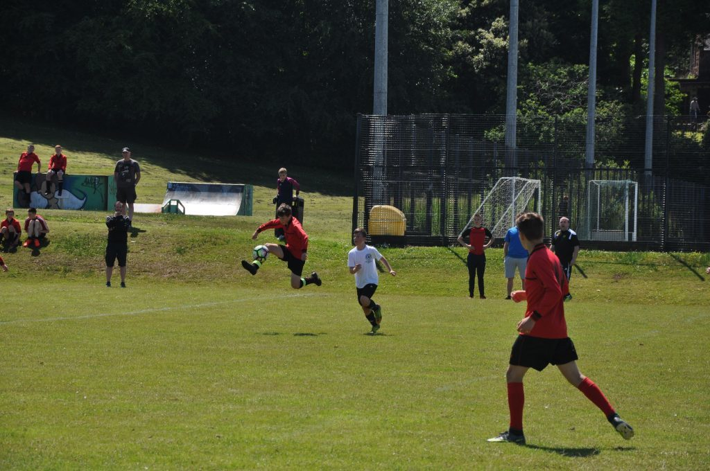 Arran's Gregor Crichton leaps into the air to claim possession of the ball.