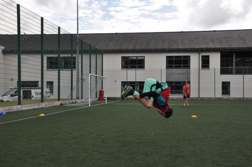 Jake Young impresses with his back flip abilities.