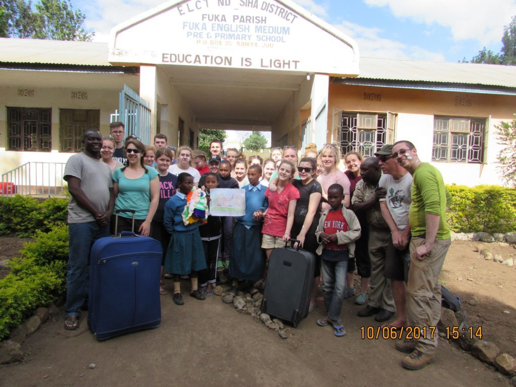 Volunteers present donations to Fuka School and Orphanage.