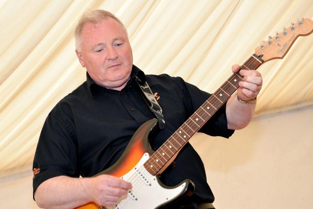 Master distiller James MacTaggart shows off his talents on the guitar. NO_B28_malt_11