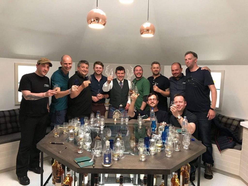 Euan Mitchell raises a glass with masterclass participants. NO_B28_malt_13