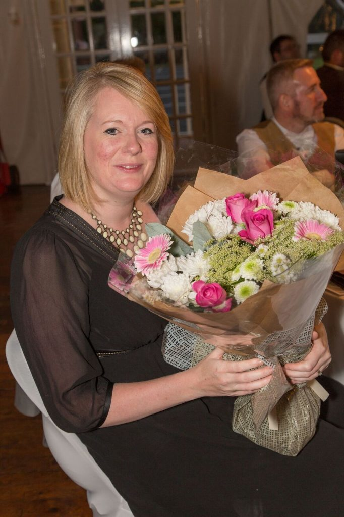 Visitor cente manager Faye Waterlow is presented with a bouquet of flowers for all her hard work organising the festival. NO_B28_malt18
