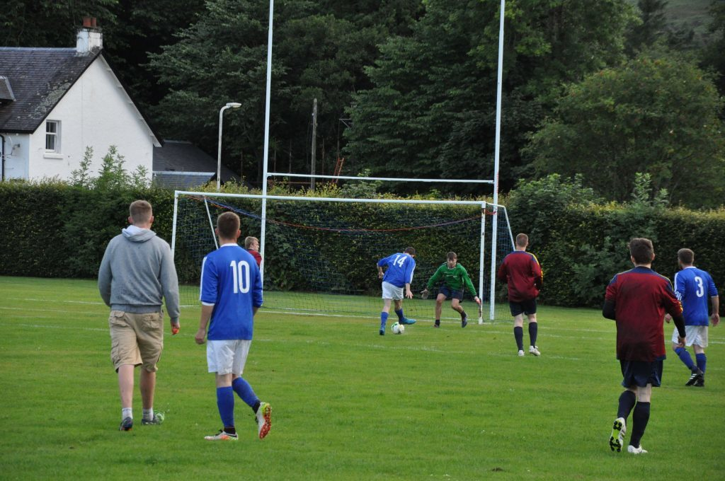 Archie McNicol scores the first of his six goals for Brodick.