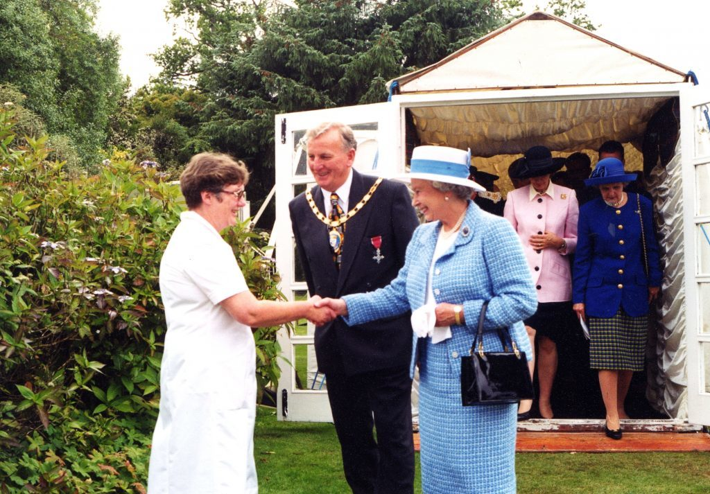 NAC convener George Steven introduces castle catering manager Judy Cook to Her Majesty.