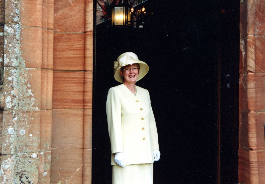 Waiting to welcome Royalty, Veronica Woodman is suitably attired.