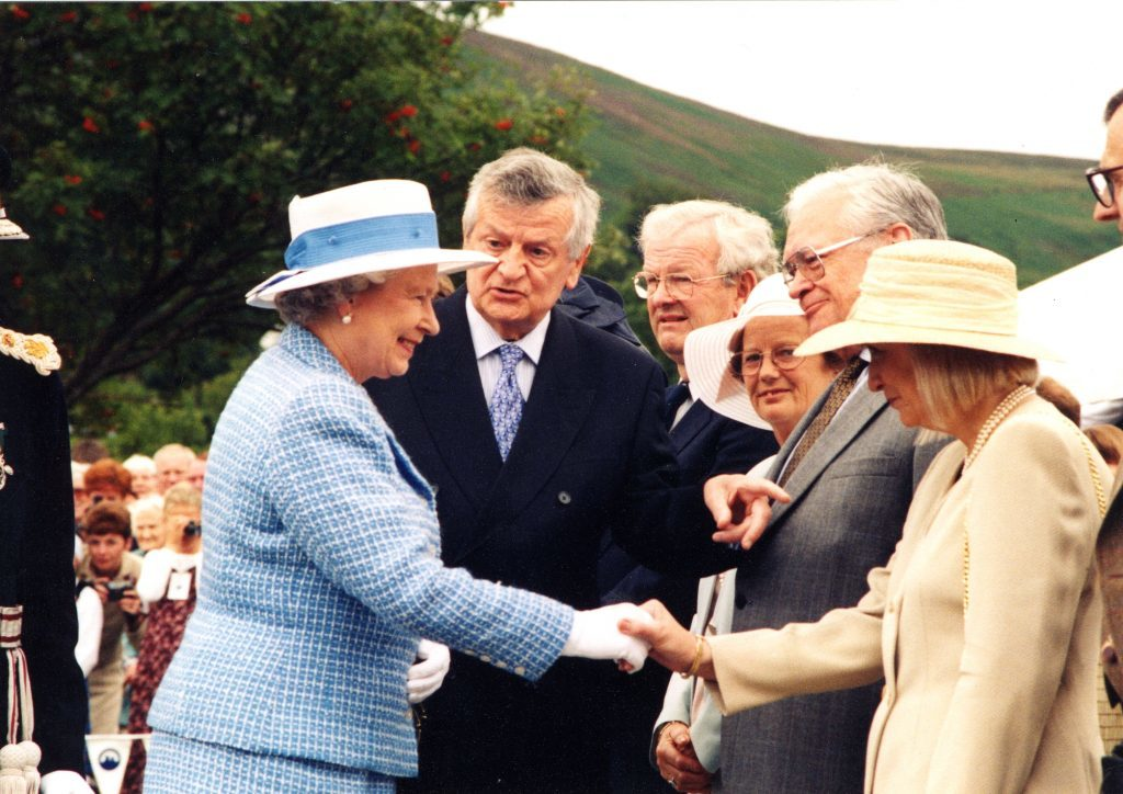The Queen is introduced to a host of dignitaries and staff during her visit.