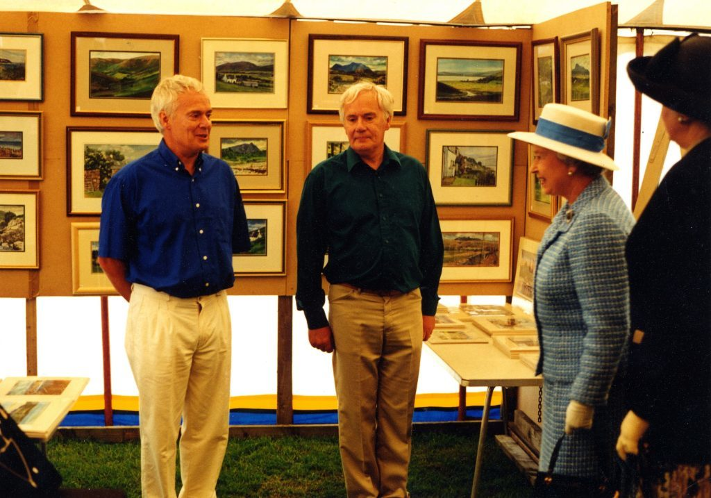 The Queen meets the Lees twins as she visits their art exhibition at the Brodick Highland Games.