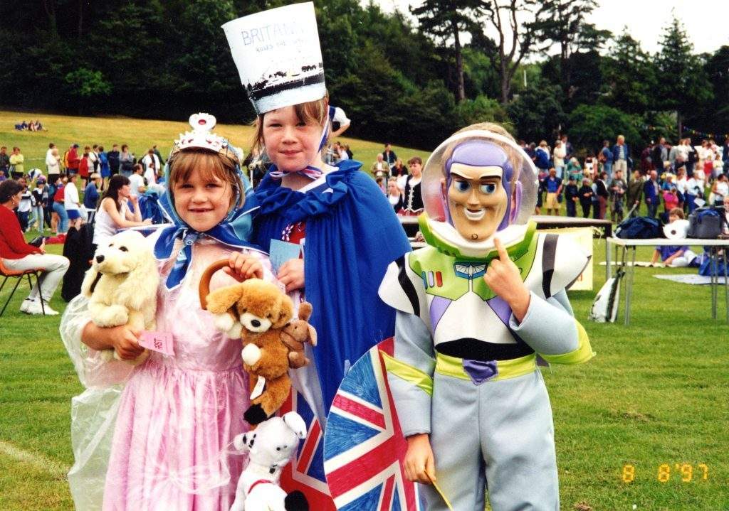 Highland Games fancy dress winners, Alice Ross, Emily Ross and Daniel Burns were eager to catch a glimpse of The Queen.