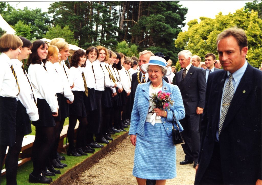 Arran High School pupils line the walkway at the Brodick castle as the Queen passes.