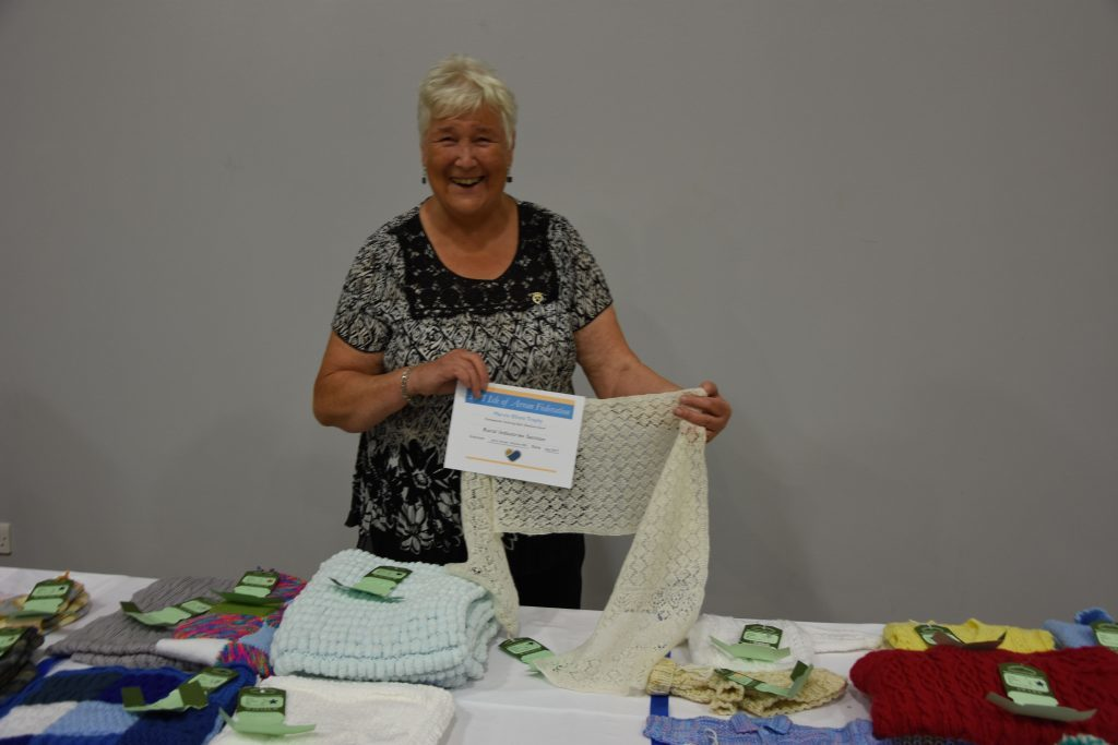 Proud winner of the Marvin Elliot Trophy, Jenny Harper of the Shiskine SWI won the award for her Shetland scarf.