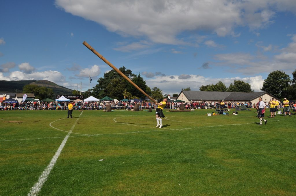 Scott Clark launches the caber.