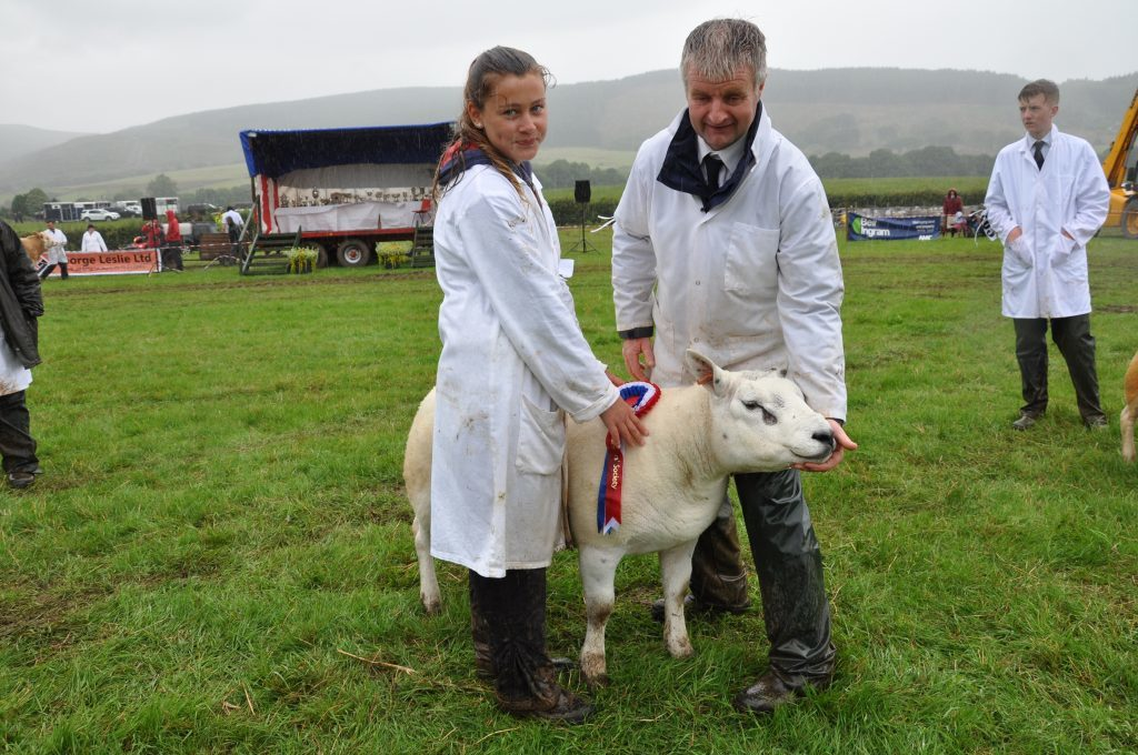 Colin Currie of Bridgend Farm, Shiskine with his champion Texel and helper Eilidh Hamill. 01_B32show03