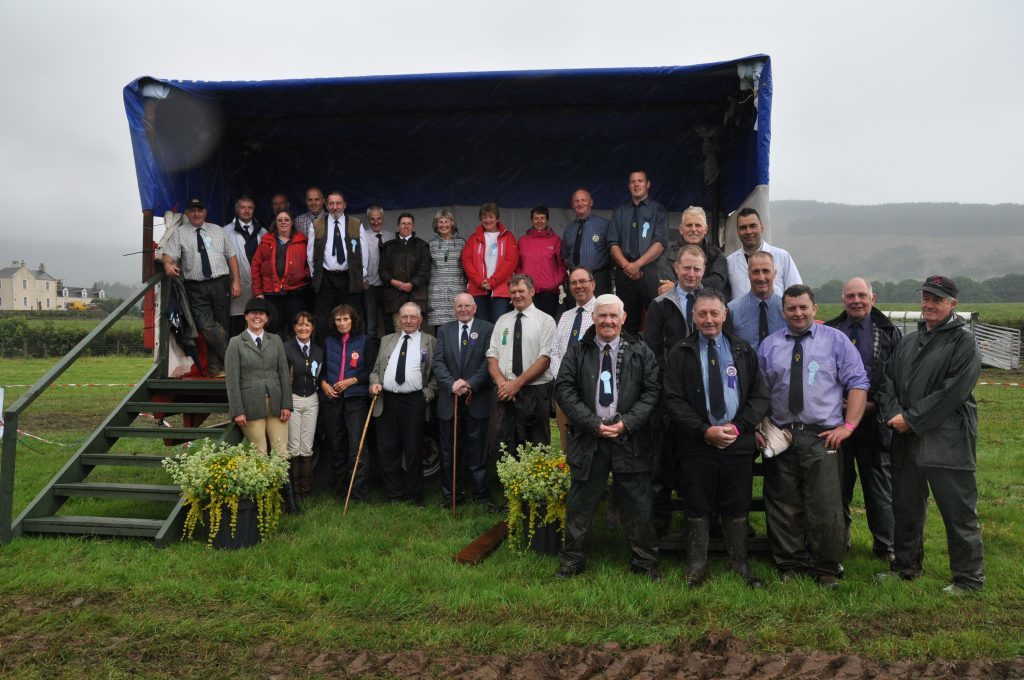 The society directors pose for a group photograph. 01_B32show04