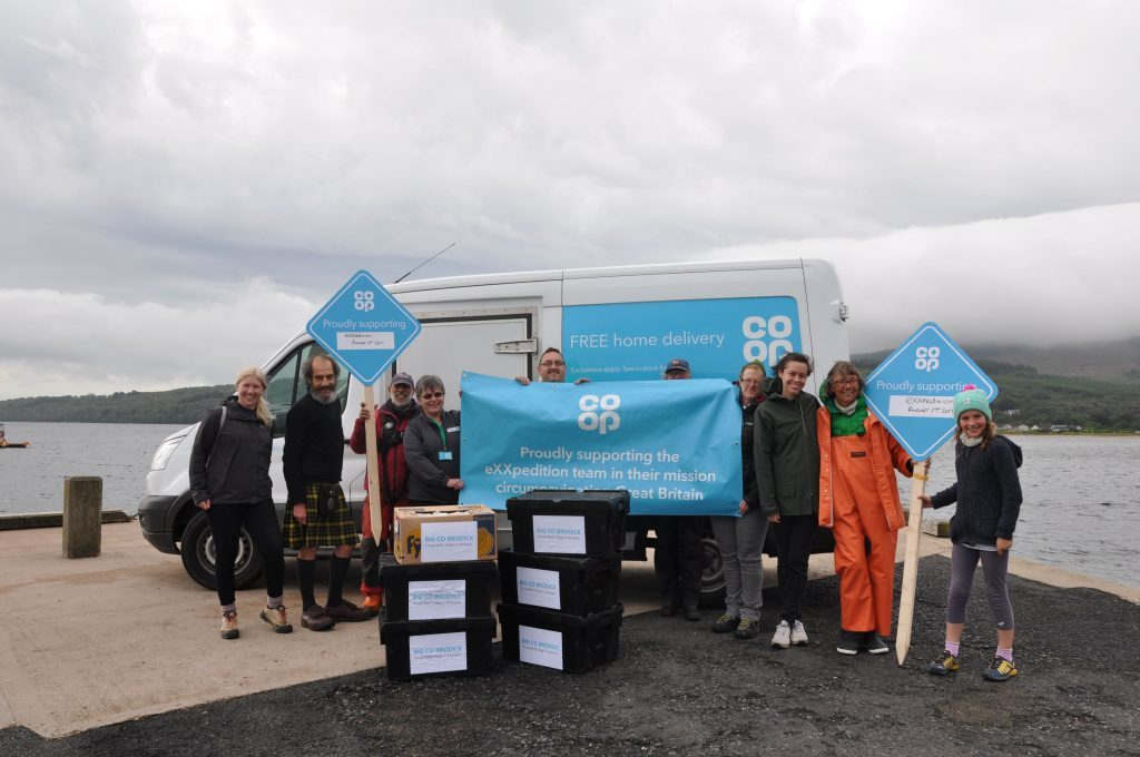Brodick Co-op staff present the crew and supporters with fresh fruit and vegetables for their onward journey.