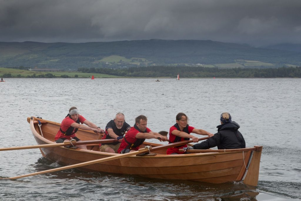 Arran Coastal rowers second coastal skiff Seabhag with a mixed set of rowers.