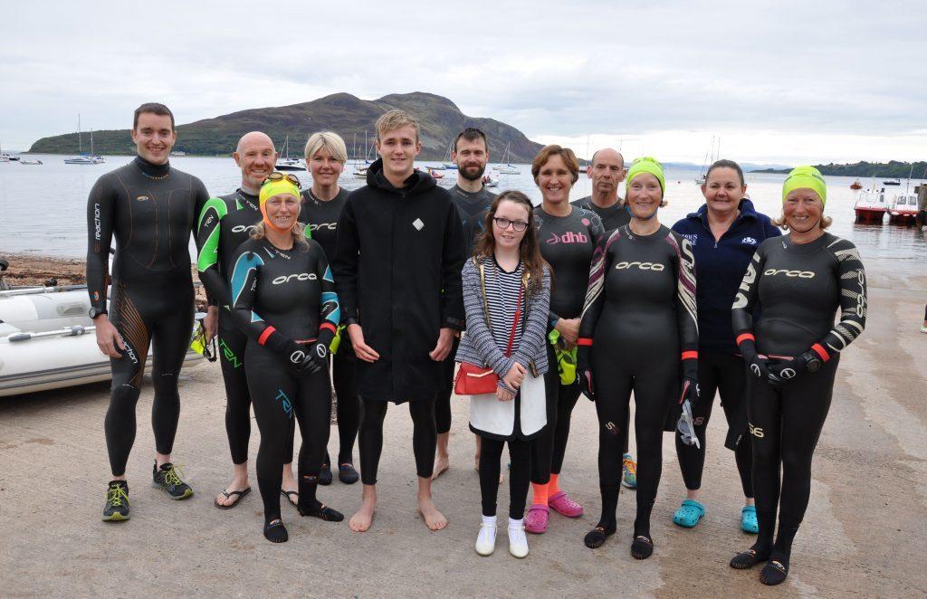 September - Heather Queen Alyssa McGarrie joins the team of 11 Arran locals who took part in the annual Lamlash Splash
