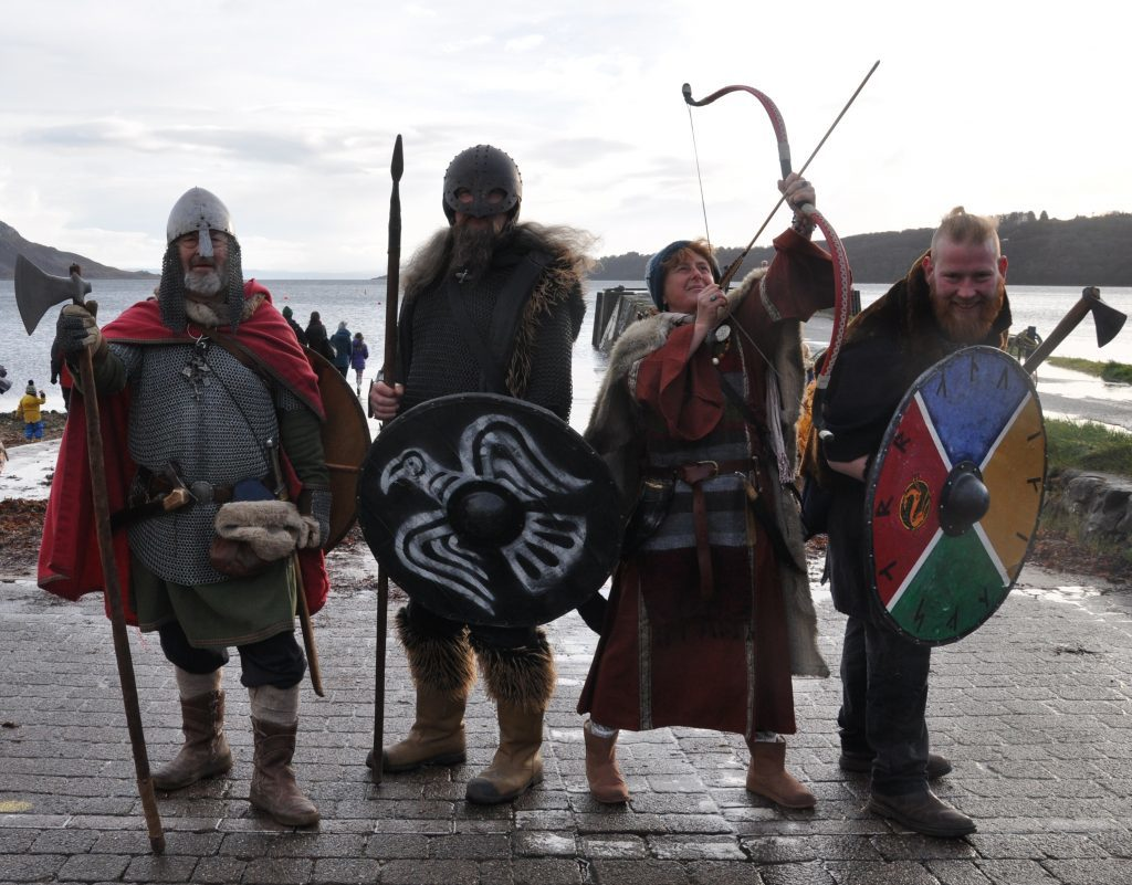 ​Members of the Arran Viking Longship Society who entertained on the day, l to r, the Rev Adrian Fallows, Stephen Sparshott, Fiona Short and Ben Jay. 01_B48sparkle01
