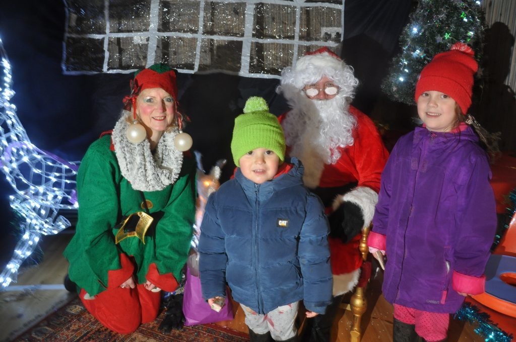 ​Santa and his Elf helper meet children in his grotto at last year's Santa Sparkle. 01_B48sparkle05