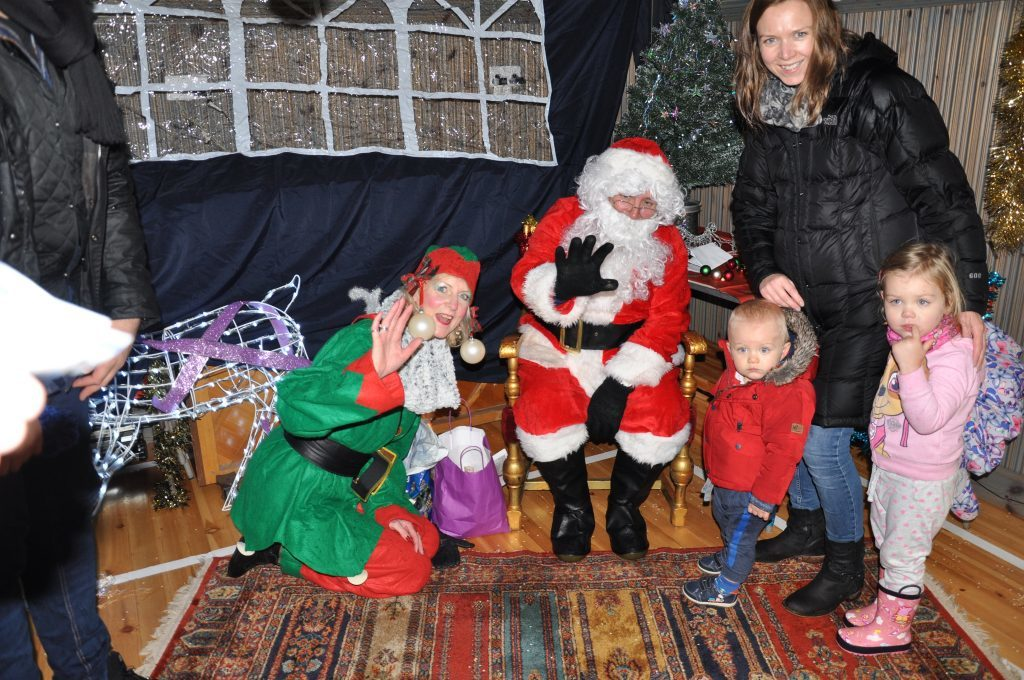​Two little children don't know what to make of meeting Santa. 01_B48sparkle06