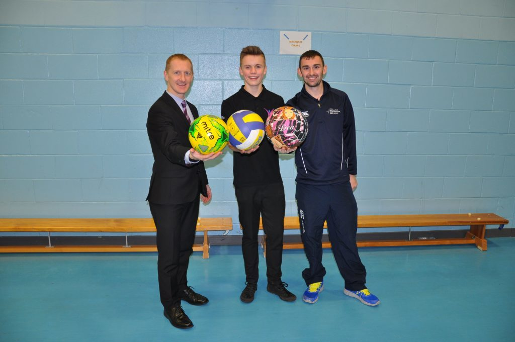 FEBRUARY - Ross Dobson, an S4 pupil at Arran High was selected by Sportscotland as the school's first young ambassador of the month. Ross Dobson is congratulated by head teacher Barry Smith and active schools co-ordinator Archie McNicol. 01_B52sport04
