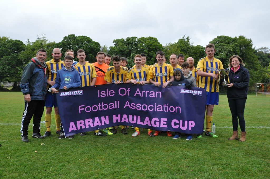MAY - Southend FC kicked off their football season by winning the Arran Haulage Cup which Danny Head received from sponsor Rachel Armitage of Arran Haulage. 01_B52sport09