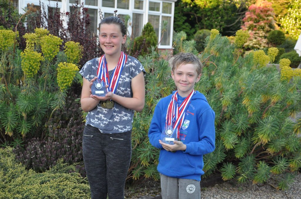 MAY - Julie Hamill and Ruaridh Lindsay-Smith were declared the champions after winning the most medals at the Arran school's swimming gala where they competed with over 100 other primary pupils. 01_B52sport10