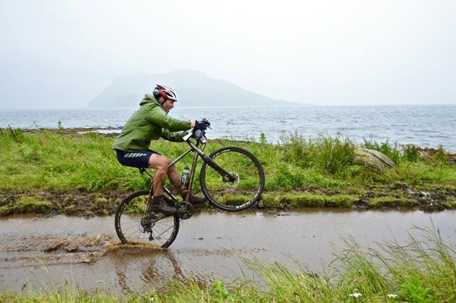 Putting on a show for the camera, a Grinduro entrant makes the most of the muddy conditions. Photo by PhotoGnick Arran