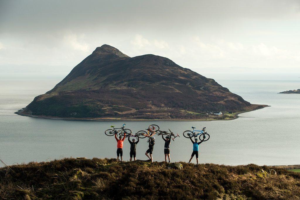 Grinduro cyclists enjoy the views over Holy Isle. Photo by Sam Needham