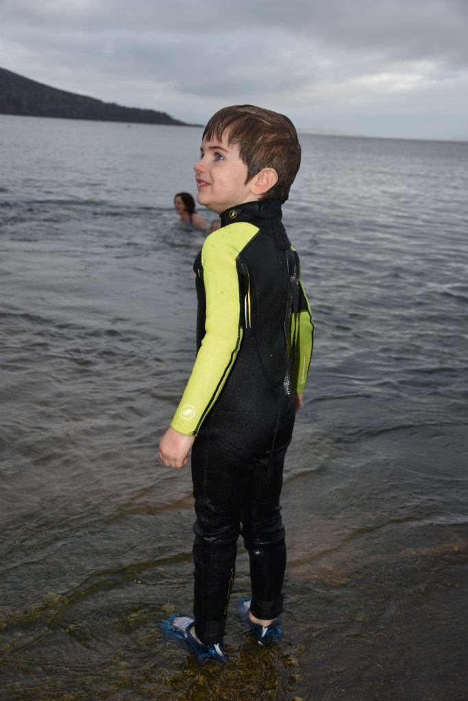 A young dooker contemplates his decision to enter the water