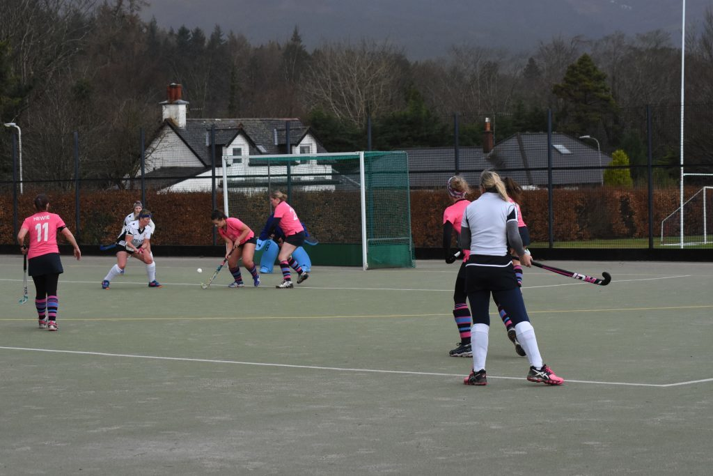 A tussle right in front of goal is rapidly curtailed by Arran's Ellie Wood