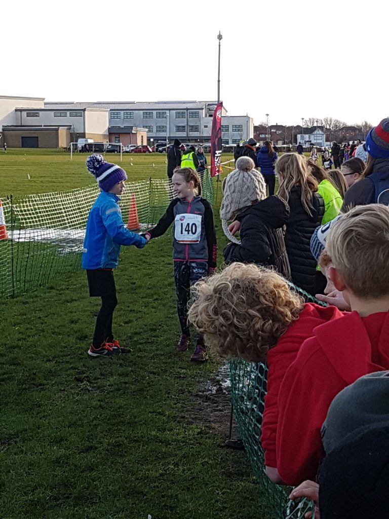 Ruaridh Lindsay-Smith congratulates Rhea Webster on winning first place