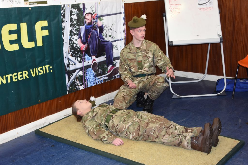 Finlay Elliot demonstrates how to put a patient in the recovery position