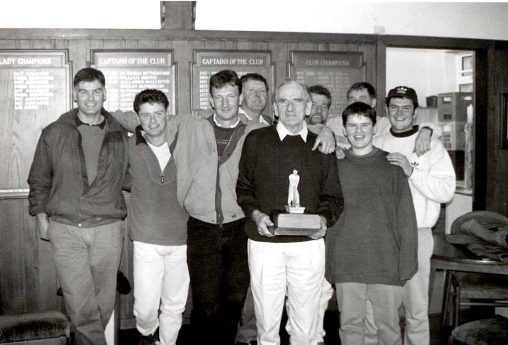Blackwaterfoot, this year's popular winners of Shiskine Golf Club's annual Ryder Cup competition. They are, l to r, Robert Waine, Peter Robertson, Robbie Crawford, James Bannatyne, DS Bannatyne with the trophy, Stewart Black, Alan Bannatyne, Brian Sherwood and Iain McLean