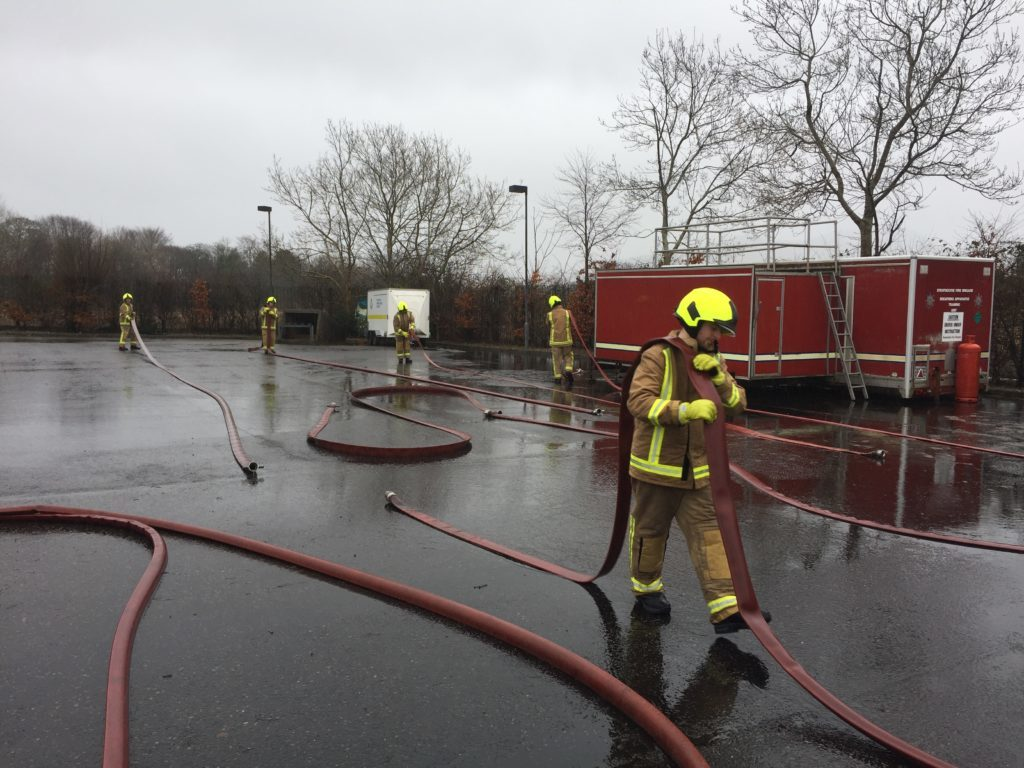 The trainees learn how to use the hoses.