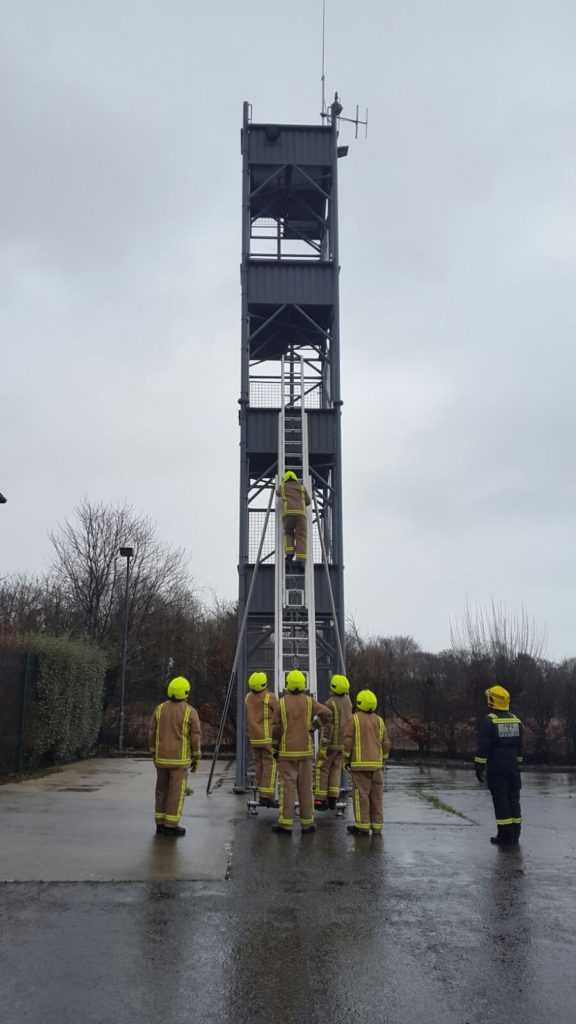 The trainees learn to perfect their ladder technique on the high tower.