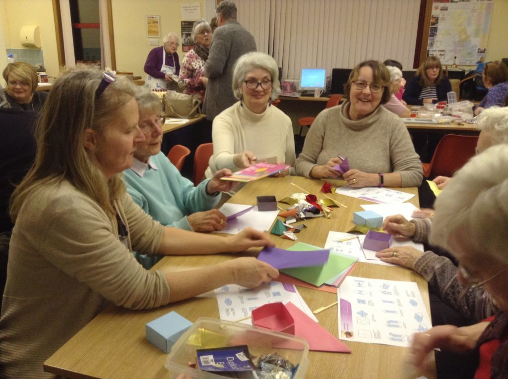 The Lamlash SWI ladies try their hand at origami.