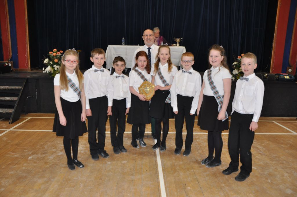 Shiskine P3 to P5 pupils receive the Associations Shield