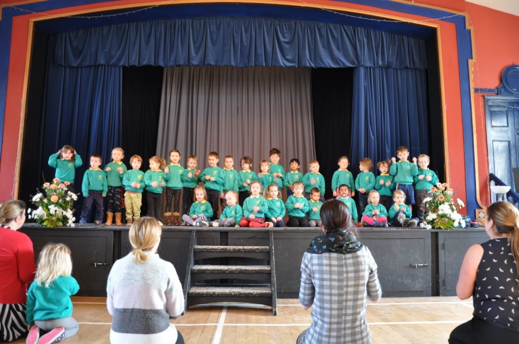 Teachers lead the Lamlash Early Years pupils who performed True Colours - complete with hand actions