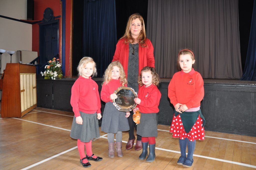 Adjudicator Lesley Wilson presented the Kilmory Early Years class with the Nancy Cooper Memorial Trophy in the actions songs section