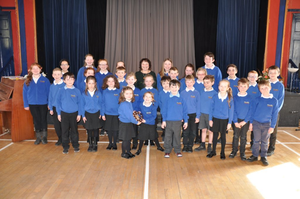 Adjudicator Heather Gough amid the children from Shiskine Primary who won the Festival Salver in the choric speaking category