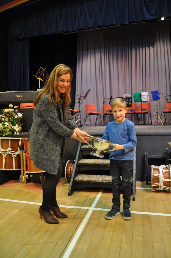Finn Popplewell receives the Elizabeth Cup for his children under eight vocal solo entitled The Cat