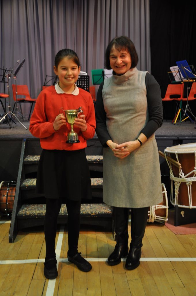 Daisy Innes and adjudicator Heather Gough with the Ormidale Cup for junior verse which she won for her Burns excerpt from Tam O'shanter