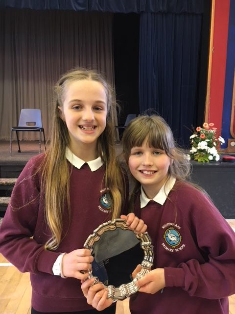 Caitlin Fraser, right, accompanied by Greta Litton took the strings solo elementary  category, winning themselves the Festival Salver