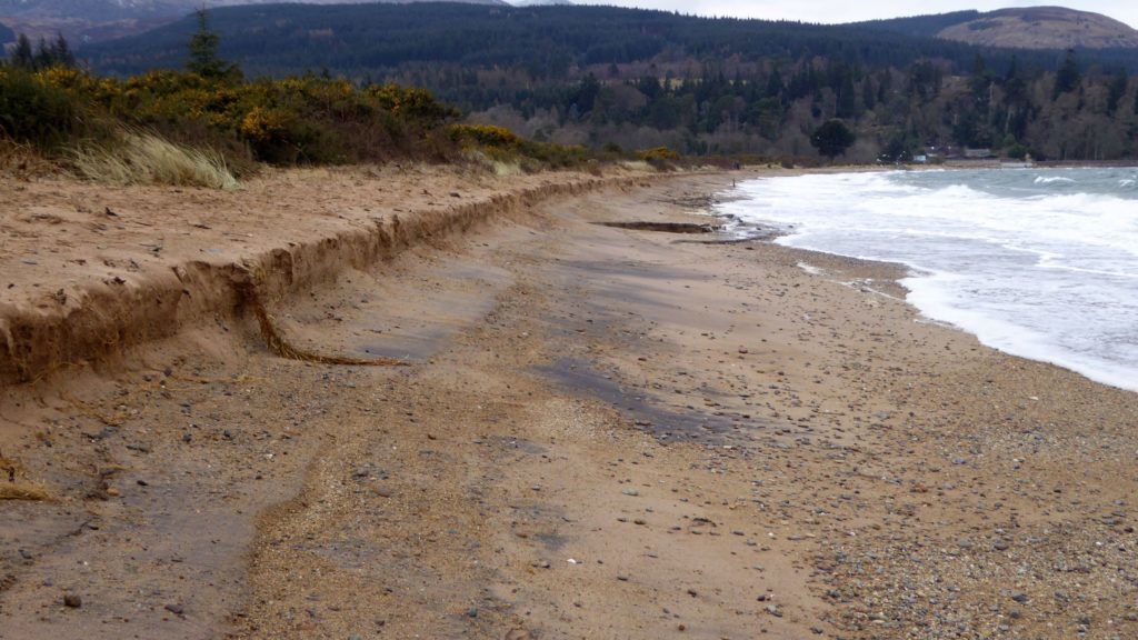 A sharp embankment shows the amount of sand that has been displaced on Brodick beach. Photo by John Baraclough