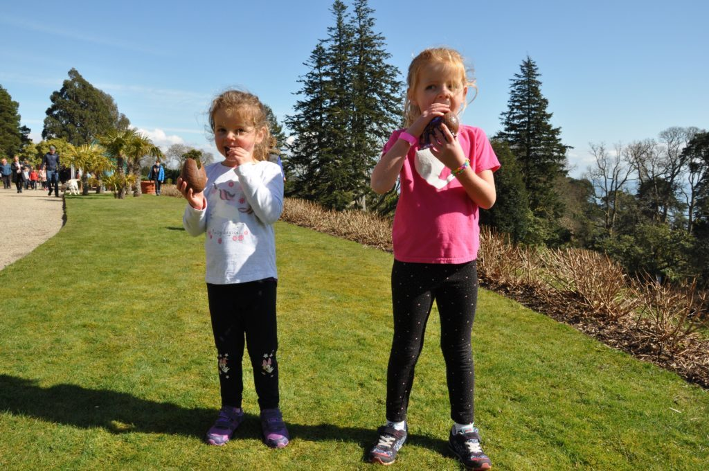 Isla and Tia McKinnon tuck into their chocolates after finishing the Easter trail challenge