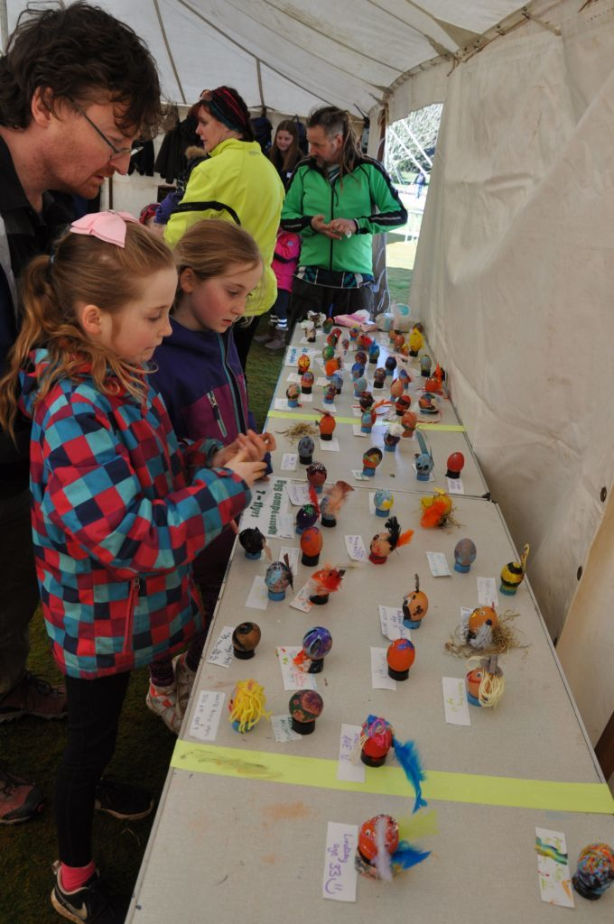 Children add their entries to the Easter egg decorating contest