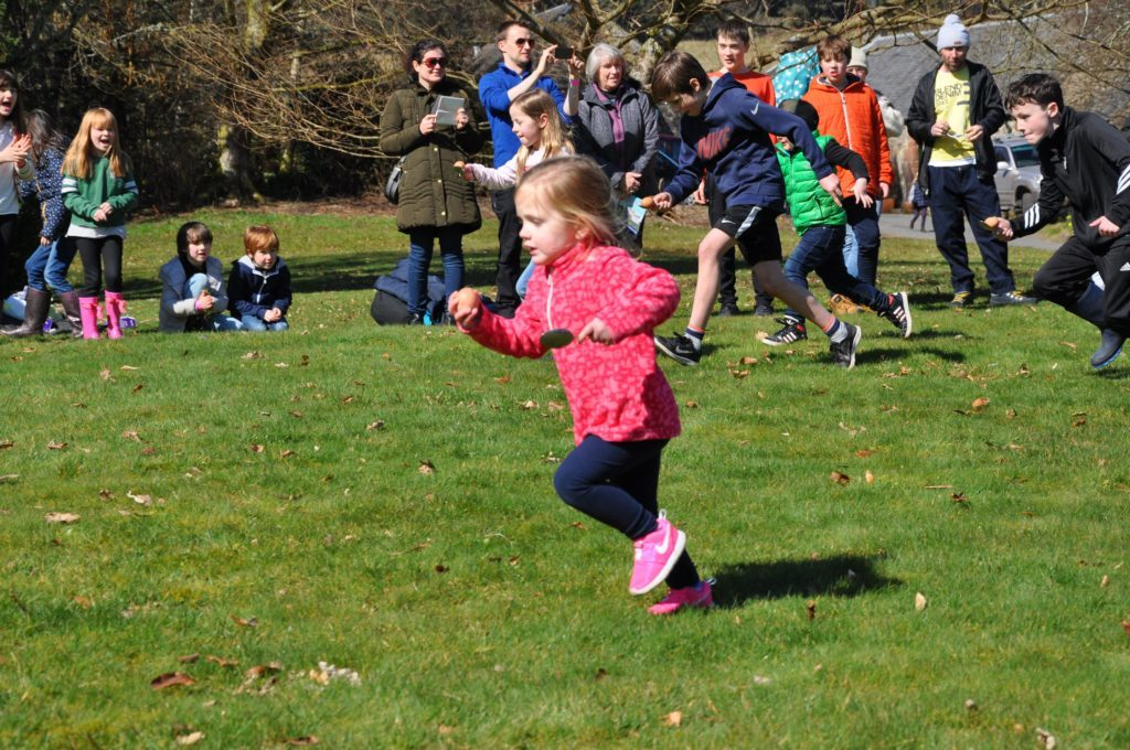 An egg and spoon race contestant finds a method of preventing her egg from falling off the spoon