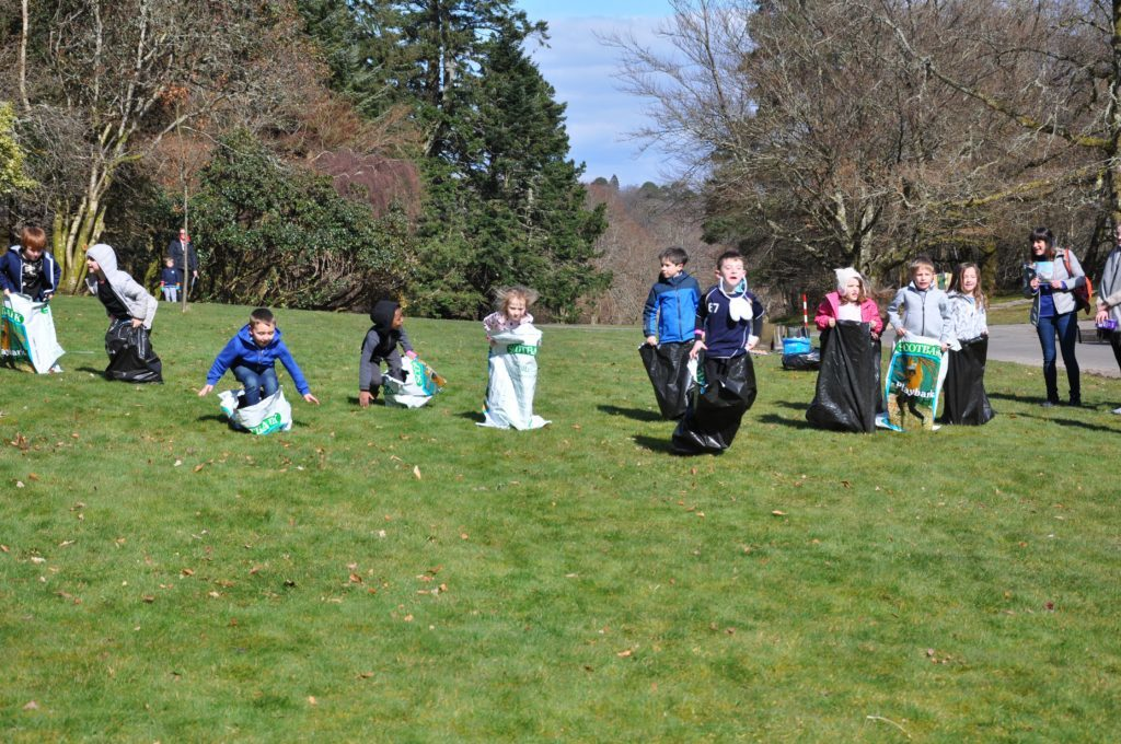 Children go tumbling in all directions during the sack race