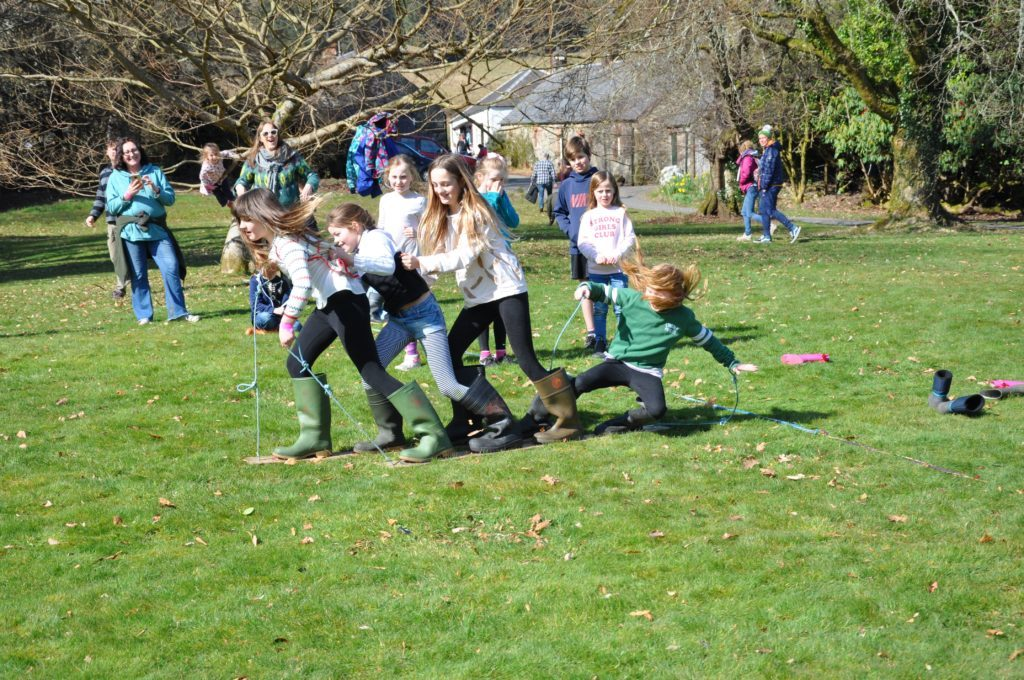 Children get to grips with the welly boot race