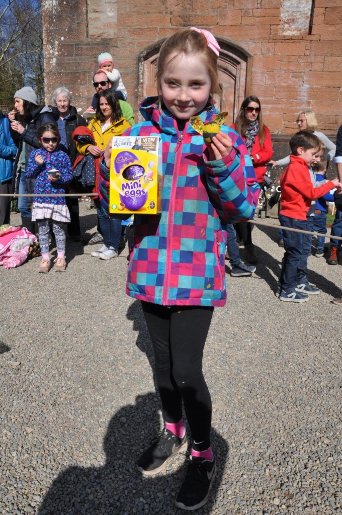 Katherine Coyle shows off her winning egg in the egg decorating competition